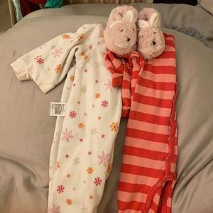 Lot of footie pajamas and slippers